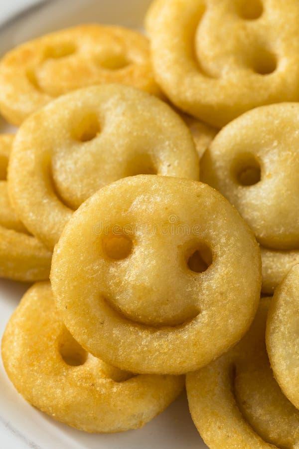 Hemlagade Smiley Face French Fries fotografering för bildbyråer