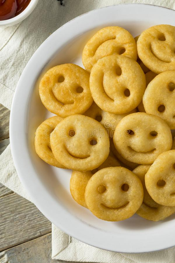 Hemlagade Smiley Face French Fries royaltyfria foton