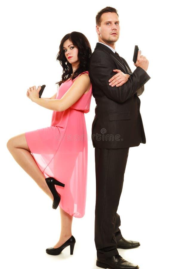 Hemlig utredning med mannen och kvinnan royaltyfria bilder