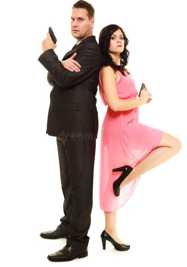 Hemlig utredning med mannen och kvinnan arkivfoto