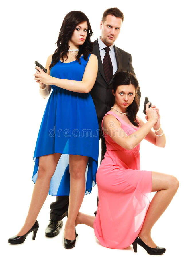 Hemlig utredning med två kvinnor och en man royaltyfri foto