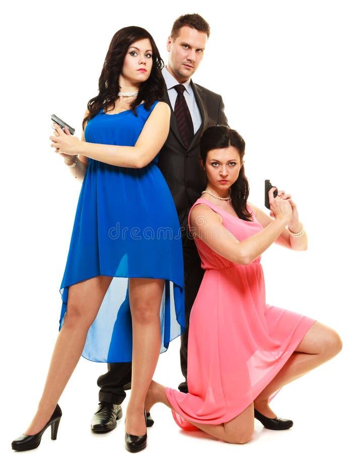 Hemlig utredning med två kvinnor och en man royaltyfria foton