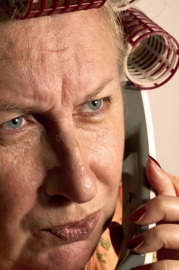 hemmafrutelefon royaltyfria bilder