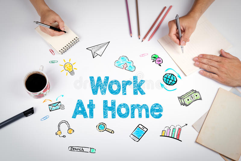 Hemmastatt begrepp för arbete Mötet på den vita kontorstabellen arkivfoto