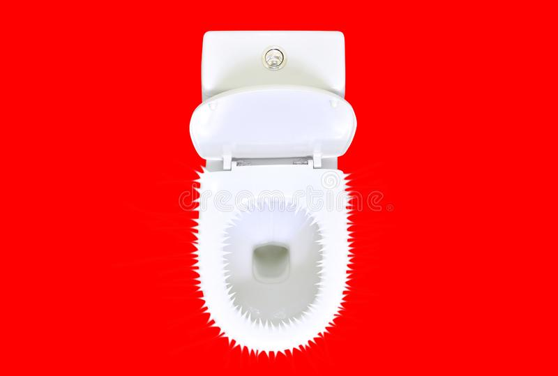 Hemorrhoids problem concept. White ceramic toilet with spikes on a red background. Hemorrhoids problem concept. White ceramic toilet with spikes on a red stock image