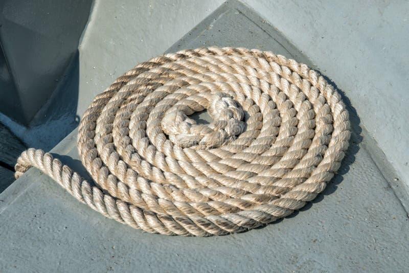 Hemp rope folded snail on marine craft royalty free stock photography