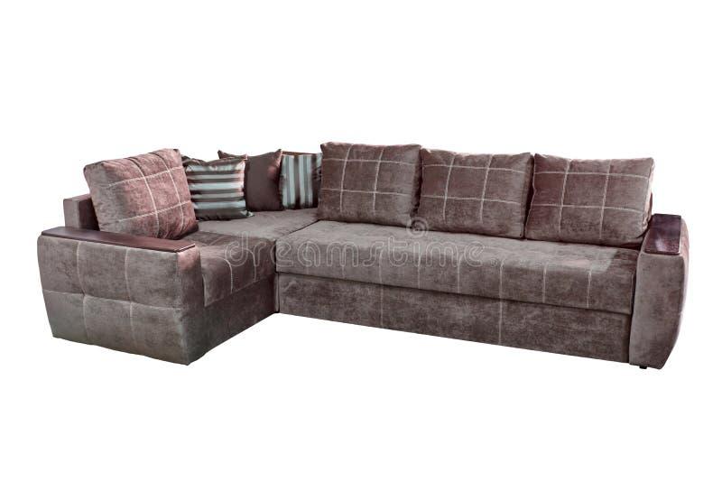 Hemtrevlig soffa för stort hörn i chokladfärg som sys med den vita tråden med kuddar arkivfoto
