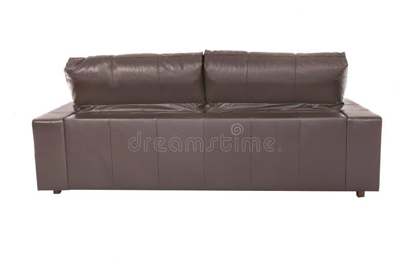 Hemtrevligt läder för stor brun soffa arkivbilder