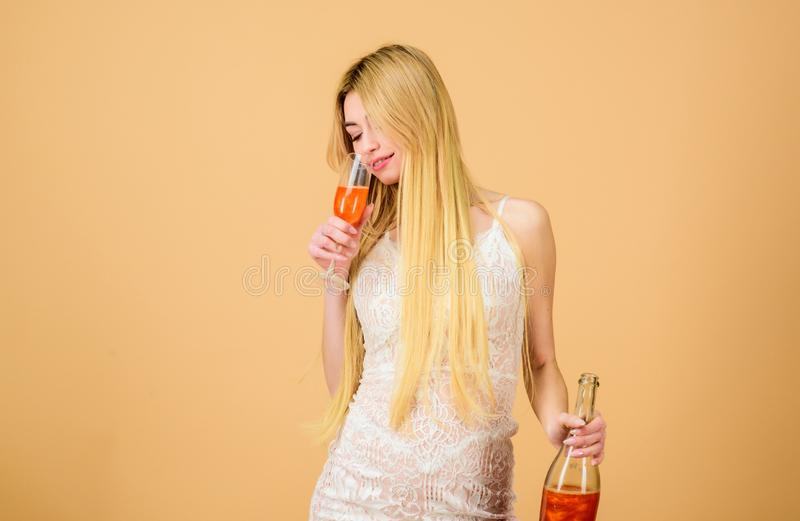 Hen party concept. Luxury champagne. Pretty blonde celebrate birthday. Sweet liquor champagne. Glamorous party. Girl. Drinking pearl glitter champagne. Woman royalty free stock images