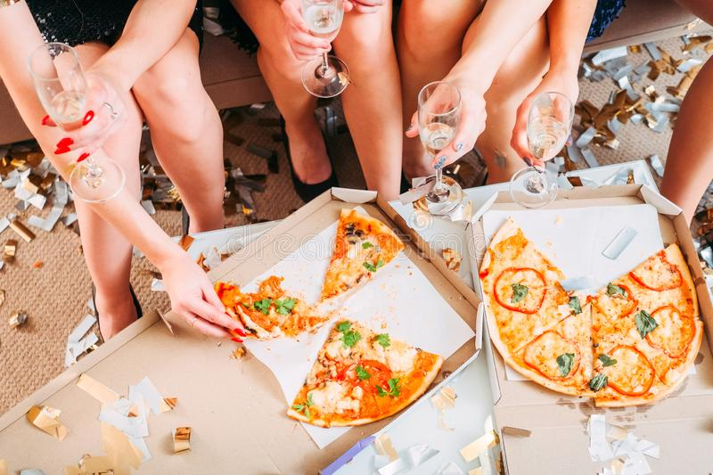 Girls hen party pizza sparkling wine celebration royalty free stock photos