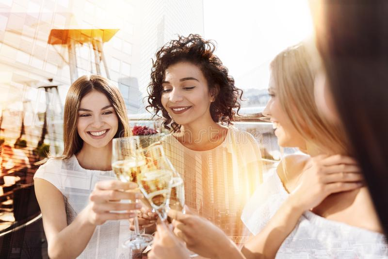 Happy cheerful women drinking alcohol stock photo