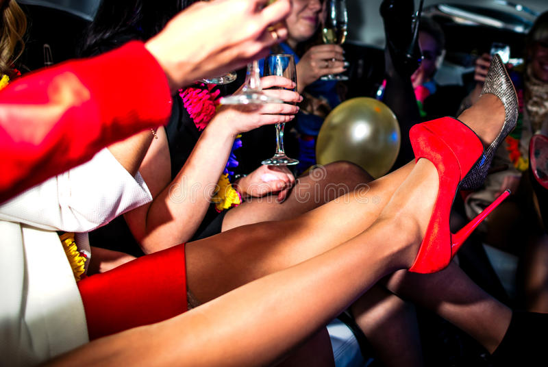 Hen-party in limo with champagne. Girls in limo at hen-party royalty free stock photo