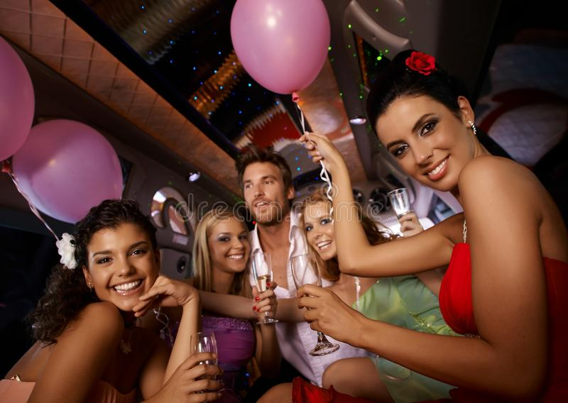Hen party in limousine. With attractive young people royalty free stock photo