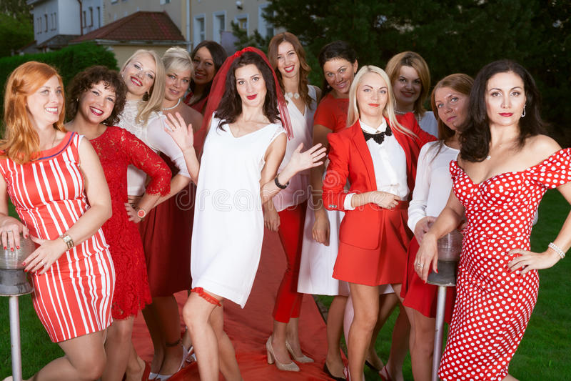 Hen party: white and red. Hen party: bridesmaid in white and red stock images