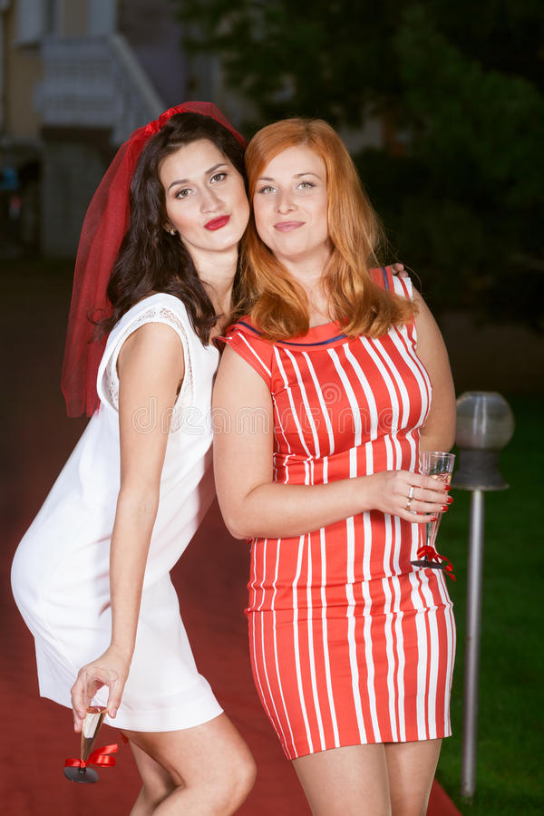 Hen party: white and red. Hen party: bridesmaid in white and red stock image