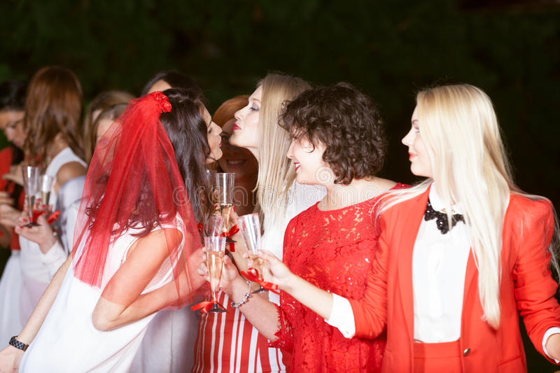 Hen party: white and red. Hen party: bridesmaid in white and red royalty free stock image