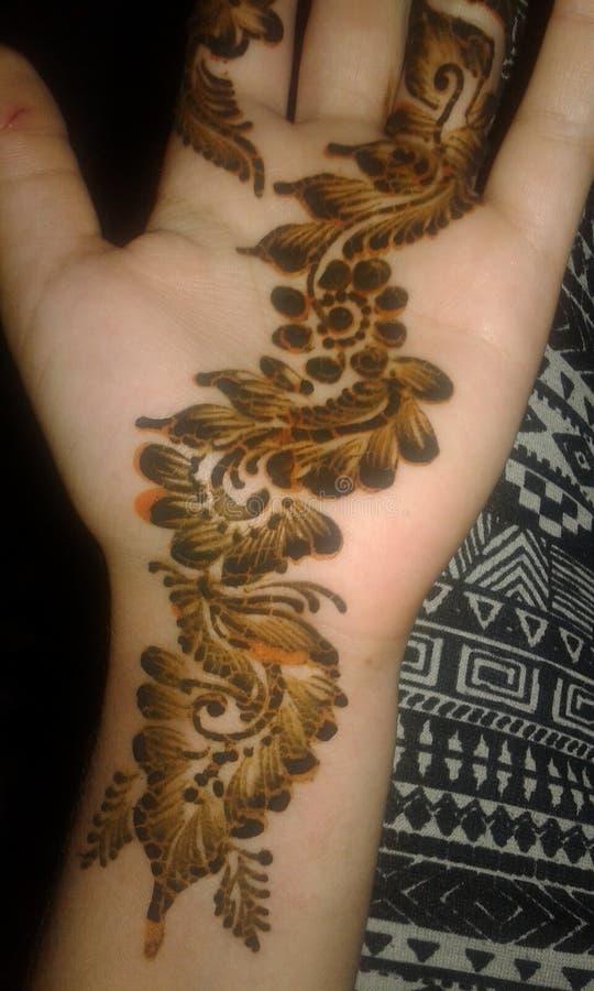 Hena na mão para uma mulher imagens de stock