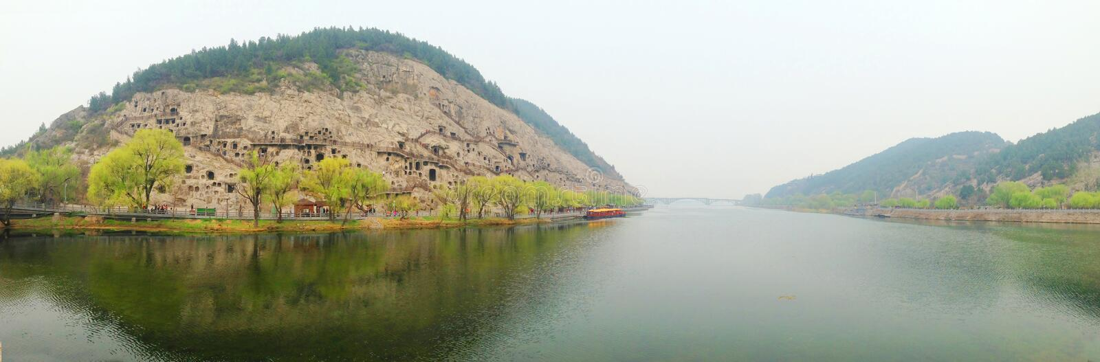 Henan, China Luoyang tourist attractions Longmen Grottoes. 180 degrees panorama. Very beautiful scenery, opposite the Sui, Tang, song and other times carved stock image