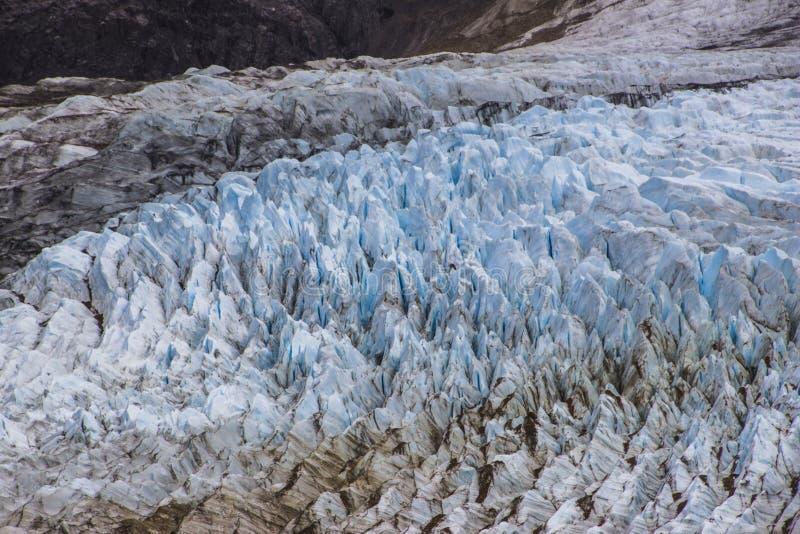 Hendiduras en el glaciar de Cerro Torre dentro de los glaciares parque nacional, la Argentina fotografía de archivo