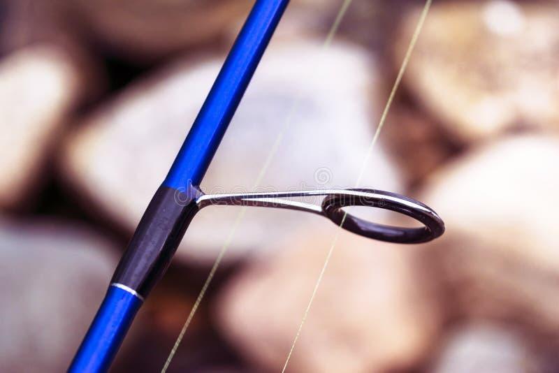 Hengel spinnende ring met het lijnclose-up Enig pictogram De staaf belt Selectieve nadruk en ondiepe Diepte van gebied Visserij t royalty-vrije stock fotografie