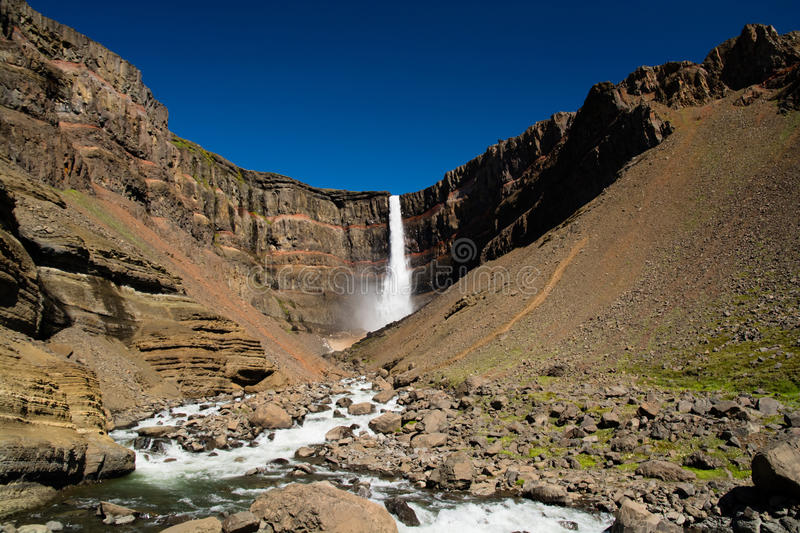 Hengifoss. Icelandic waterfall Hengifoss with its red clay layers royalty free stock photos
