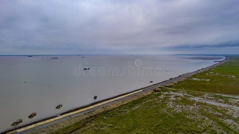 Hengsha Dongtan. Chongming District, Shanghai, China is located at the mouth of the Yangtze River on the east side of Hengsha Island. The Tonghai levee, which stock photo