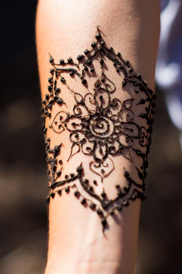 Henna arm art. Tribal Henna art designs on arm at vintage pop up markets stock photos