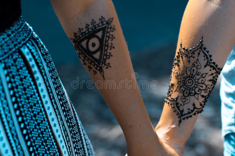 Henna arm art. Tribal Henna art designs on arm at vintage pop up markets royalty free stock photo