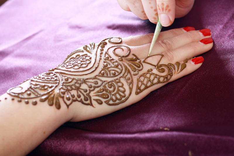 Henna being applied stock photos