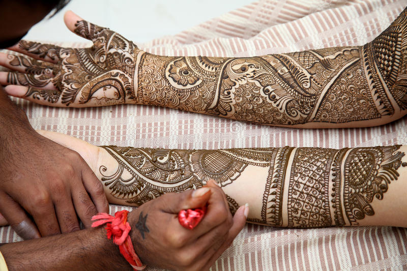 Henna being applied to bride's hand royalty free stock photo