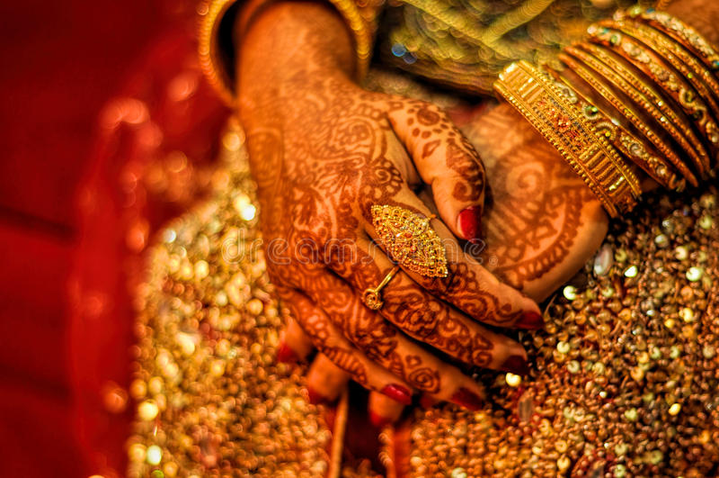 Henna on brides hands. Traditional henna on brides hands on wedding in Bangladesh stock photo