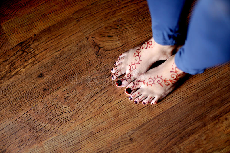 Henna Designs on Foot. Henna designs on a woman's foot royalty free stock photography