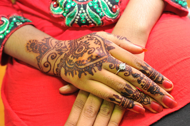 Henna. Is a dye prepared from the plant Lawsonia inermis, also known as hina, the  tree, the mignonette tree, and the Egyptian privet, the sole species of the royalty free stock photography