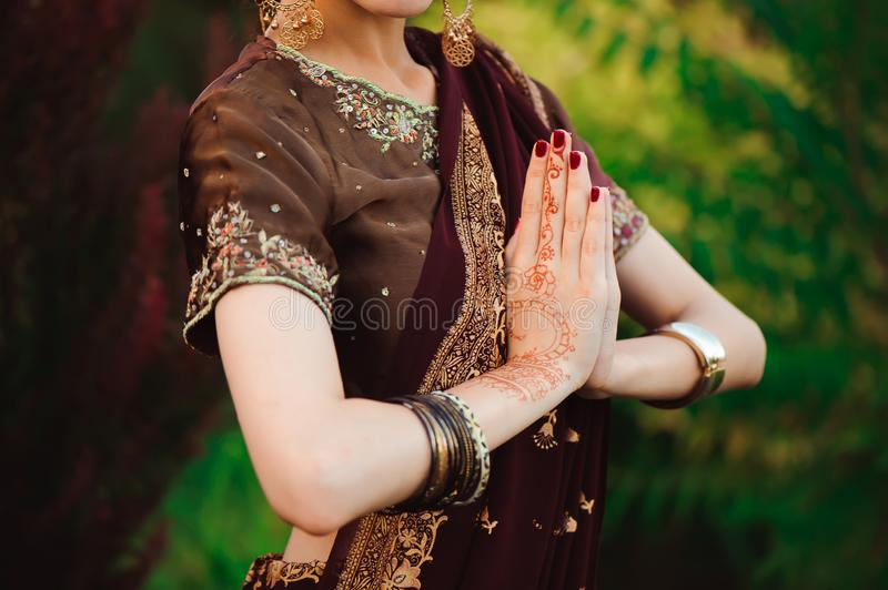 Henna wedding design, Woman Hands with black mehndi tattoo. Hands of Indian bride girl with black henna tattoos. Fashion royalty free stock photos