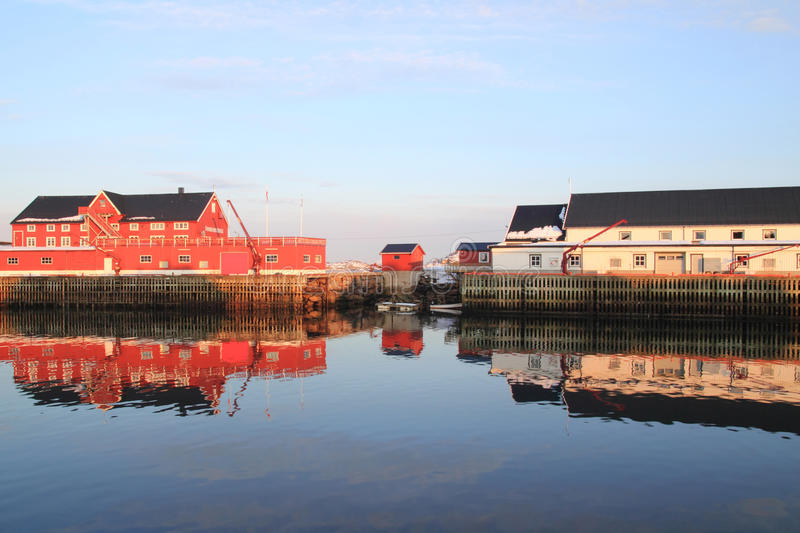 Henningsvaer building mirroring. Mirrors in Henningsvaer's main channel, Lofoten islands, Norvegian arctic sea stock photo