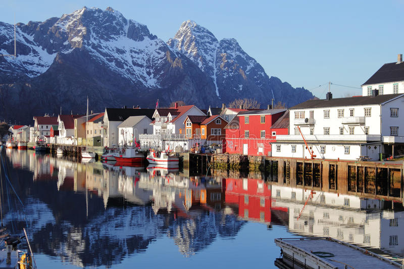 Henningsvaer spring mirrors. Mirrors in Henningsvaer's main channel, Lofoten islands, Norvegian arctic sea stock photography