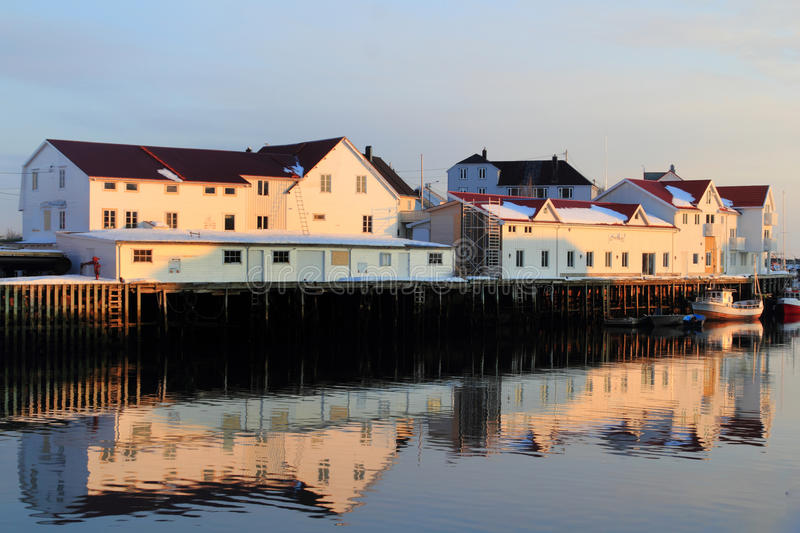 Henningsvaer white buildings mirroring. Mirrors in Henningsvaer's main channel, Lofoten islands, Norvegian arctic sea royalty free stock photography