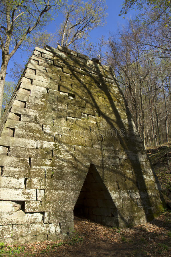 Henry Clay Furnace. Stone pyramid of Henry Clay Furnace in Coopers Rock State Forest, West Virginia against blue sky royalty free stock photography