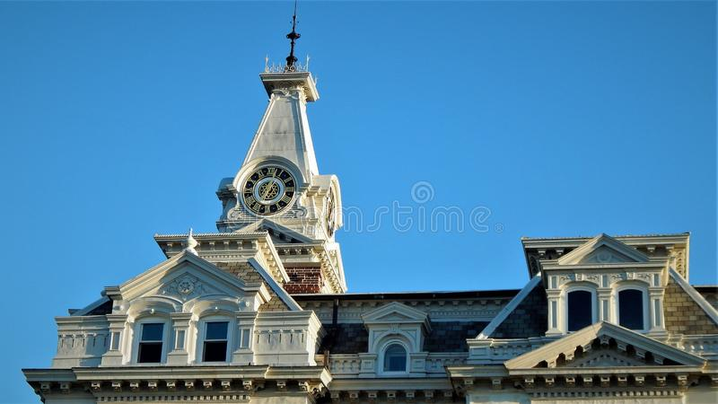 Henry County Courthouse. Completed in 1880 the Henry County Courthouse in Cambridge Illinois features ornate detail and a clock tower above its Mansard roof. The royalty free stock photos