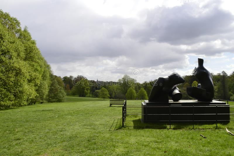 Henry Moore Sculpture in the grounds of Kenwood House Hampstead London Uk. Henry Moore`s Two Piece Reclining Figure in the public grounds and parkland of kenwood royalty free stock images