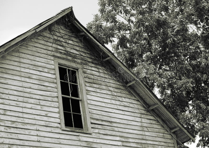Henry River Mill Village. Its glass long gone, a darkened window watches silently over the ghost town of Henry River Mill Village in North Carolina, the filming royalty free stock image