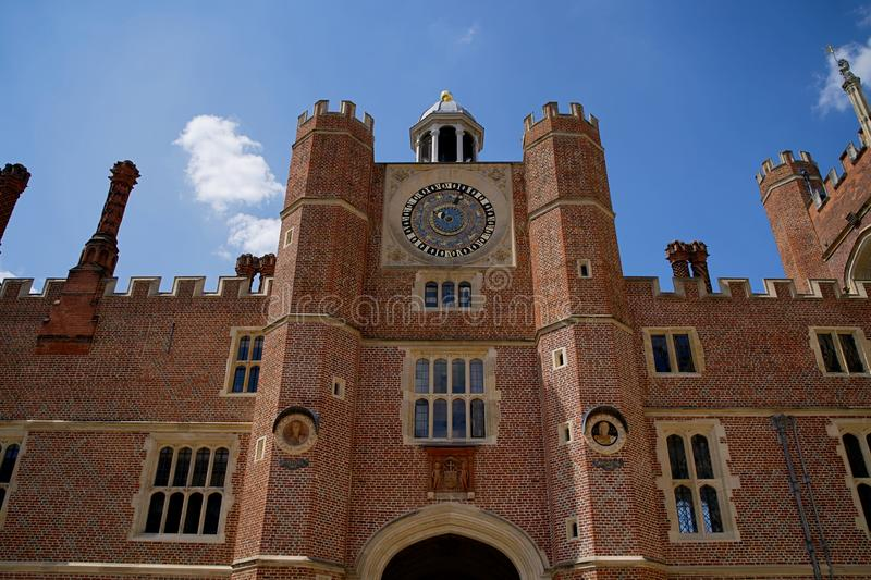 Henry VIII`s Astronomical Clock at Hampton Court Palace Clock Court. Viewed against blue sky. royalty free stock photos