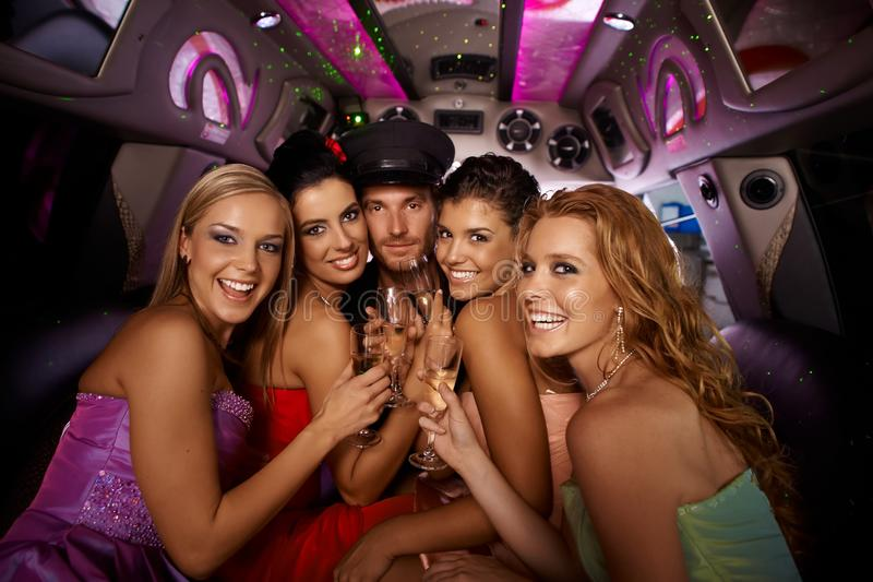 Hens night in limousine. With happy young attractive people royalty free stock image