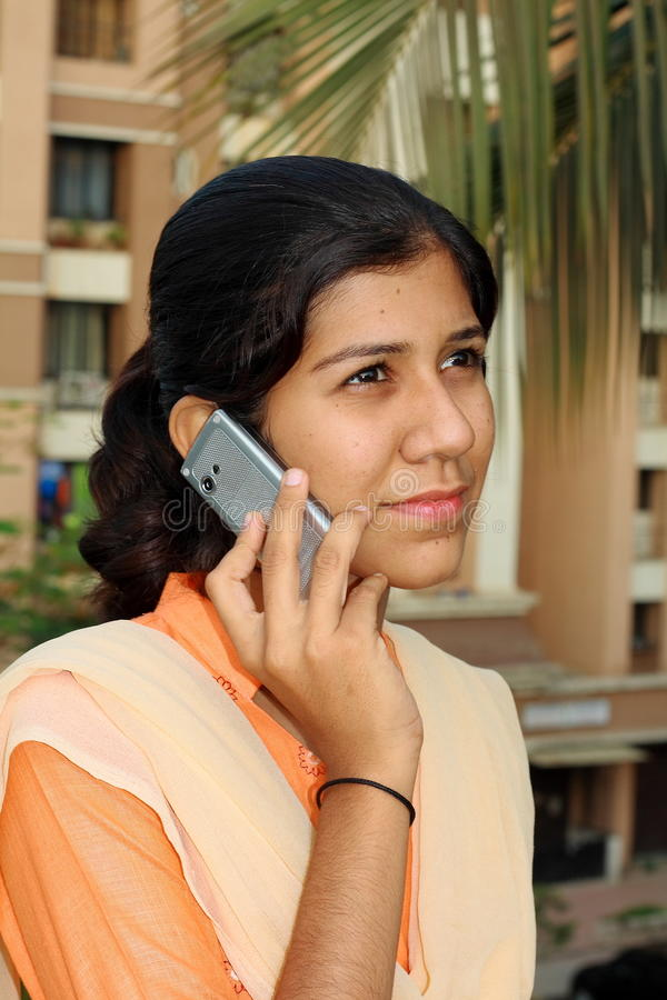 Her bright aspirations. A smart village girl from India taking the call royalty free stock images