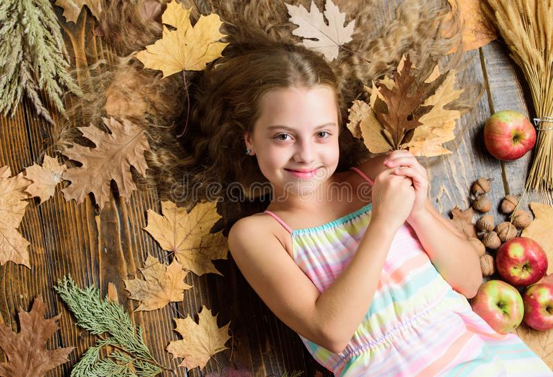 Her hair at its best. Little girl with wavy hairstyle on fall background. Small beauty model with fall look. Hair salon. For kids. Pretty girl with long royalty free stock images