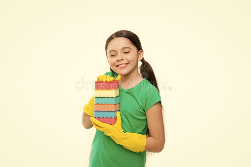 Her kitchen sponges. Little housemaid ready for household help. Small housekeeper holding dish sponges in rubber gloves. Adorable kitchen maid. Household royalty free stock images