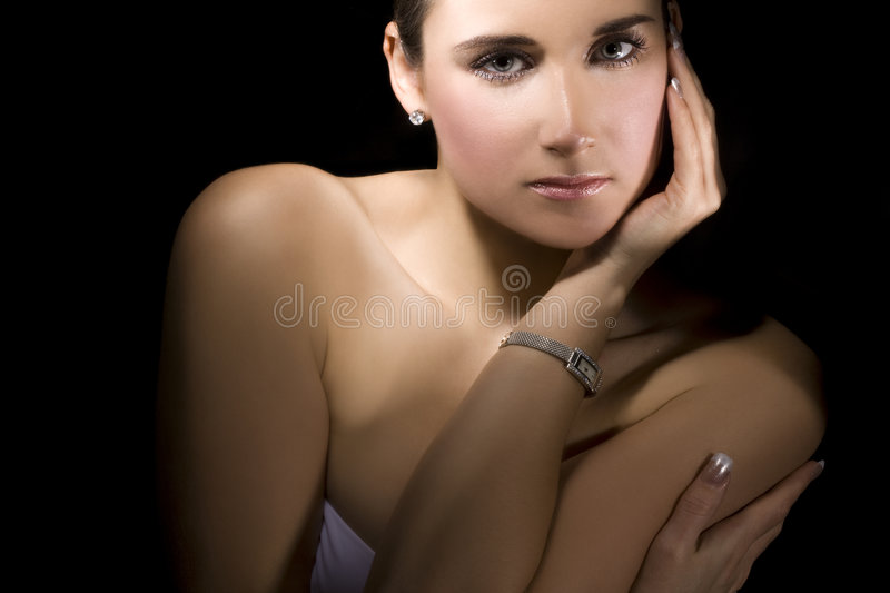 Her silver wristwatch stock photo