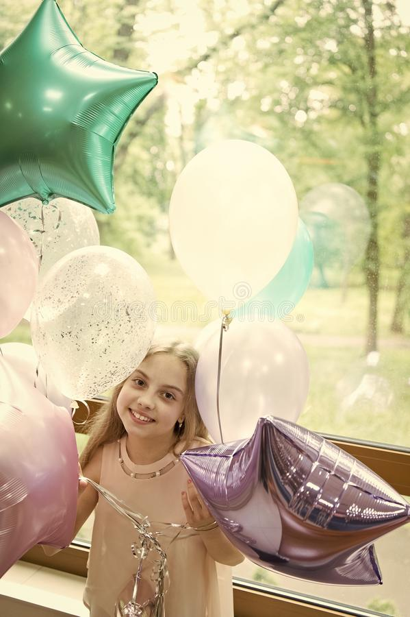 Her special day. Birthday celebration. Happiness and joy. Art balloons decorations service. Girl with balloons celebrate royalty free stock image