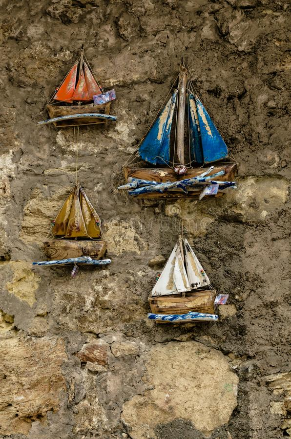 HERAKLION, GREECE - November, 2017: Wooden toy boats under multi royalty free stock photography
