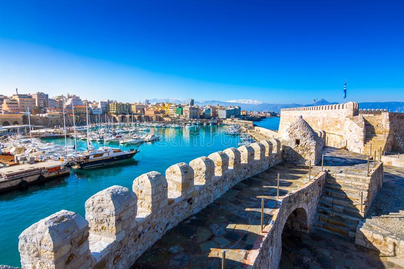 Heraklion harbour with old venetian fort Koule and shipyards, Crete. Heraklion harbour with old venetian fort Koule and shipyards, Crete, Greece stock images